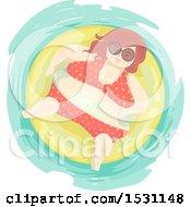 Chubby Woman In A Bikini Floating In An Inner Tube