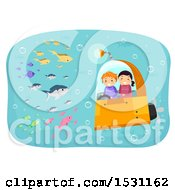 Boy And Girl Riding In A Submarine And Viewing Fish