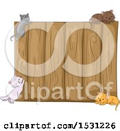 Clipart Of A Wooden Fence With Kitty Cats Royalty Free Vector Illustration
