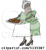 Clipart Of A Black Woman Holding A Sheet Of Brownies Royalty Free Vector Illustration