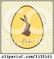 Silhouetted Bunny On An Easter Egg Over Polka Dots