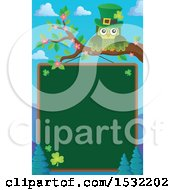 Clipart Of A Green St Patricks Day Owl On A Branch Over A Chalkboard Royalty Free Vector Illustration