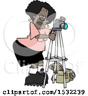 Black Female Photographer Taking Pictures With A Camera On A Tripod