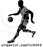 Clipart Of A Silhouetted Black And White Basketball Player Dribbling Royalty Free Vector Illustration