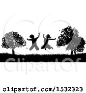 Clipart Of A Black And White Border Of Silhouetted Children Jumping Outdoors Royalty Free Vector Illustration by AtStockIllustration