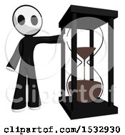 Clipart Of A Maskman By A Giant Hourglass Royalty Free Illustration by Leo Blanchette