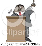 Black Male Politician Holding Up A Finger At A Podium
