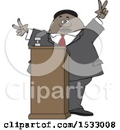 Black Male Politician Gesturing Peace Or Victor At A Podium