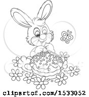 Black And White Bunny Rabbit With An Easter Cake