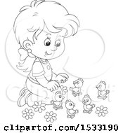 Black And White Little Girl Kneeling And Playing With Spring Chicks