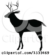 Clipart Of A Black Silhouetted Deer Stag Buck Royalty Free Vector Illustration by AtStockIllustration