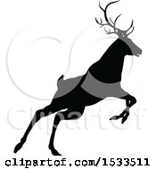 Clipart Of A Black Silhouetted Deer Stag Buck Rutting Royalty Free Vector Illustration
