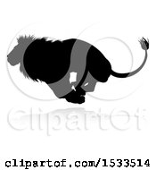Silhouetted Male Lion Running With A Reflection Or Shadow