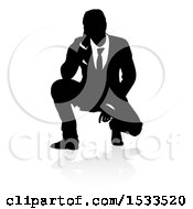 Silhouetted Business Man Crouching With A Reflection Or Shadow