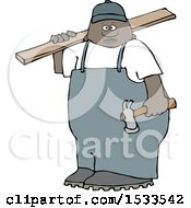 Black Male Carpenter Carrying A Wood Board