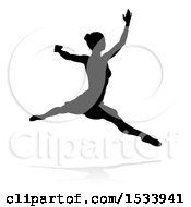 Silhouetted Ballerina Leaping With A Reflection Or Shadow On A White Background