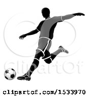 Silhouetted Soccer Player In Action