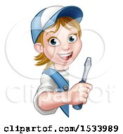 White Female Electrician Holding A Screwdriver Around A Sign