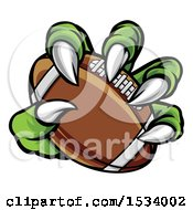 Clipart Of A Green Monster Claw Holding An American Football Royalty Free Vector Illustration