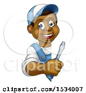Poster, Art Print Of Black Male Electrician Holding A Screwdriver Around A Sign