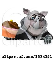 Clipart Of A 3d Business Rhinoceros Holding A Cupcake On A White Background Royalty Free Illustration