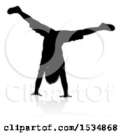 Silhouetted Boy Doing A Hand Stand With A Reflection Or Shadow On A White Background