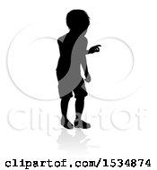 Silhouetted Boy With A Reflection Or Shadow On A White Background