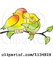 Pair Of Love Birds Cuddling On A Branch