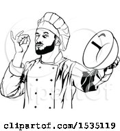 Black And White Male Chef Gesturing Perfect And Holding A Bowl
