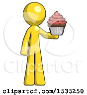 March 16th, 2018: Yellow Design Mascot Man Presenting Pink Cupcake To Viewer by Leo Blanchette