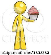 March 16th, 2018: Yellow Design Mascot Woman Presenting Pink Cupcake To Viewer by Leo Blanchette
