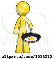 March 16th, 2018: Yellow Design Mascot Man Frying Egg In Pan Or Wok by Leo Blanchette