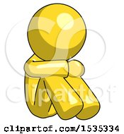 Yellow Design Mascot Man Sitting With Head Down Facing Angle Right