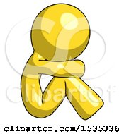 Yellow Design Mascot Man Sitting With Head Down Facing Sideways Right