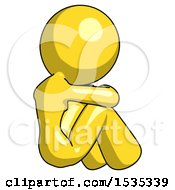 Yellow Design Mascot Woman Sitting With Head Down Back View Facing Right