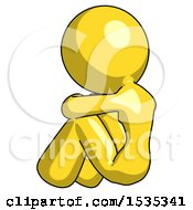 Yellow Design Mascot Woman Sitting With Head Down Back View Facing Left