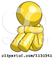 Yellow Design Mascot Man Sitting With Head Down Facing Angle Left