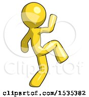 Yellow Design Mascot Man Kick Pose Start