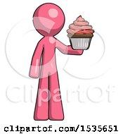 Pink Design Mascot Man Presenting Pink Cupcake To Viewer