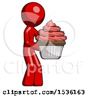 Red Design Mascot Man Holding Large Cupcake Ready To Eat Or Serve
