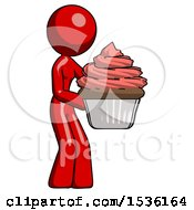 Red Design Mascot Woman Holding Large Cupcake Ready To Eat Or Serve