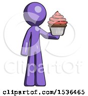 Purple Design Mascot Man Presenting Pink Cupcake To Viewer