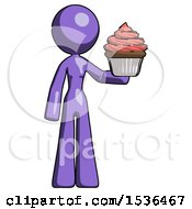 Purple Design Mascot Woman Presenting Pink Cupcake To Viewer