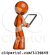 Orange Design Mascot Man Looking At Tablet Device Computer Facing Away