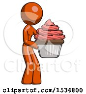 Orange Design Mascot Woman Holding Large Cupcake Ready To Eat Or Serve