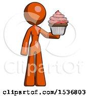 Orange Design Mascot Woman Presenting Pink Cupcake To Viewer