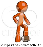 Orange Design Mascot Man Standing With Foot On Football
