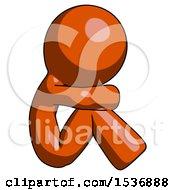 Orange Design Mascot Man Sitting With Head Down Facing Sideways Right