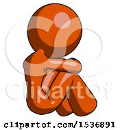 Orange Design Mascot Woman Sitting With Head Down Back View Facing Right