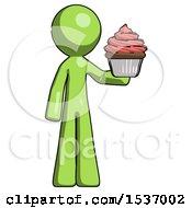 Green Design Mascot Man Presenting Pink Cupcake To Viewer